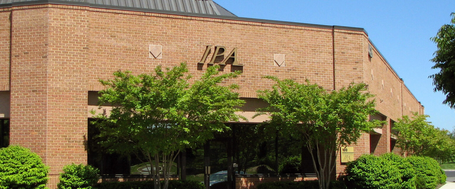 Photo of the front of IPA's corporate office in Ashburn, Virginia.